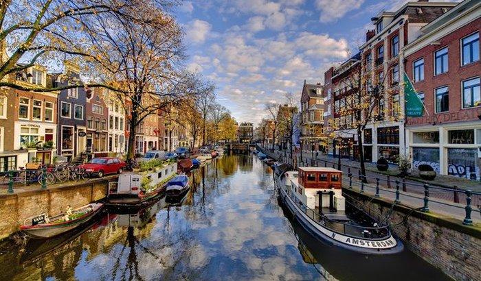 Ajude um estranho a viajar para amsterdam